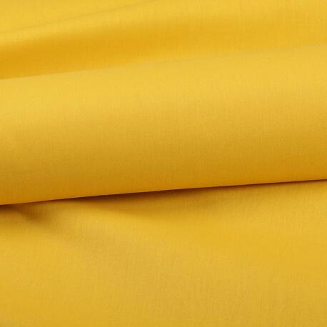 Tissu coton uni jaune curcuma